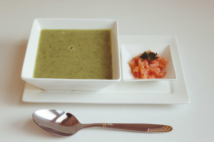 Creamy zucchini soup with smoked salmon on the side as topping